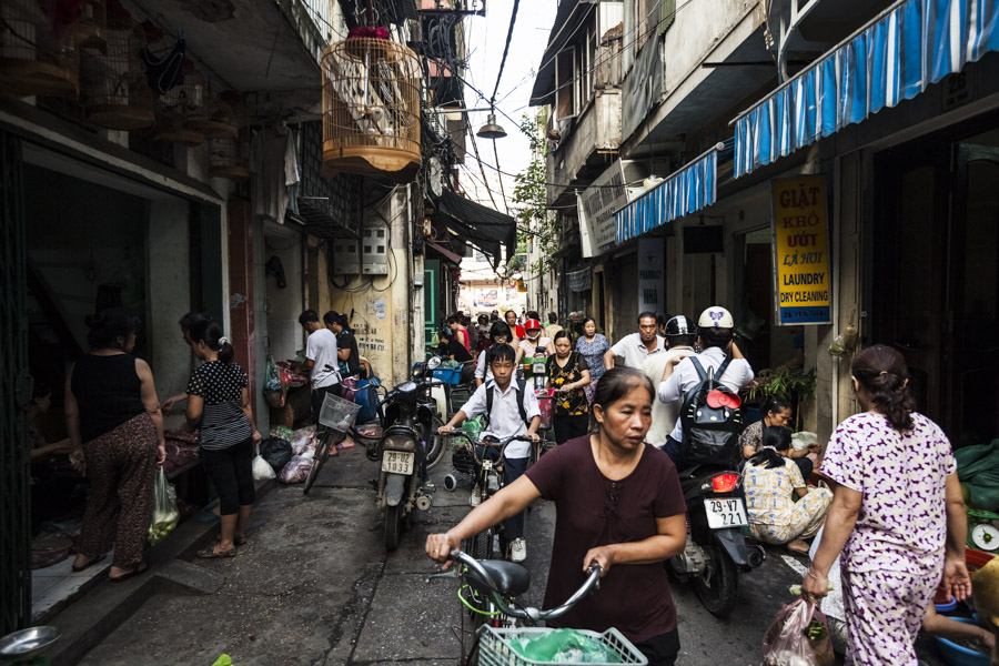 A crowded, narrow alley in Hanoi's Old Quarter.