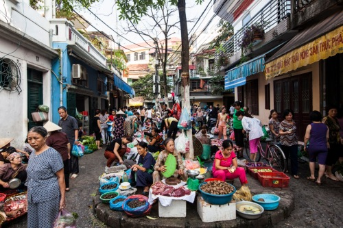 A local market scene in Hanoi, Vietnam.