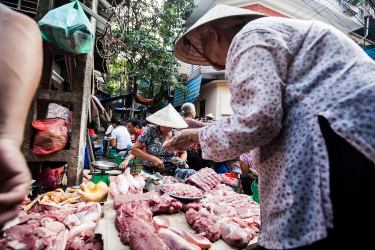 A local market scene in Hanoi, Vietnam.