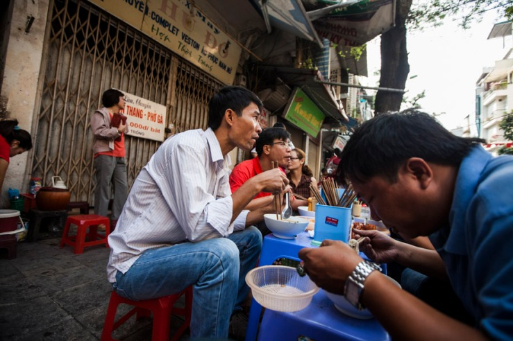 Eating pho on the street at 9 Hang Trong street in downtown Hanoi, Vietnam.