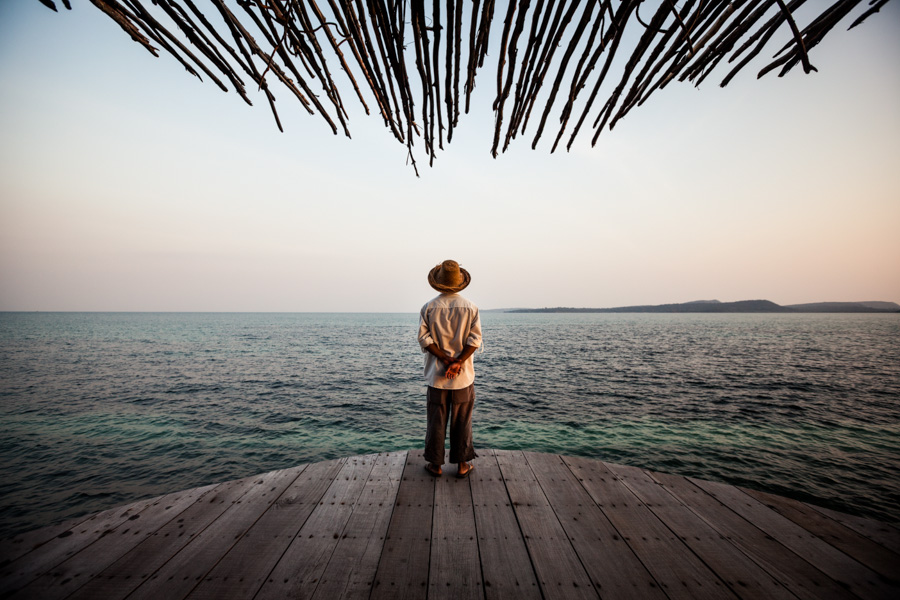 A man overlooks the Gulf of Thailand from a balcony at the Song Saa resort, on its own private island off the coast of Sihanoukville, Cambodia.