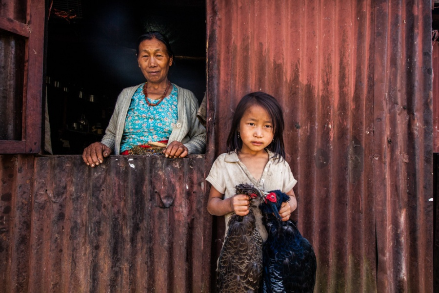 A portrait of a grandmother and granddaughter in an Angami village in Nagaland, India.