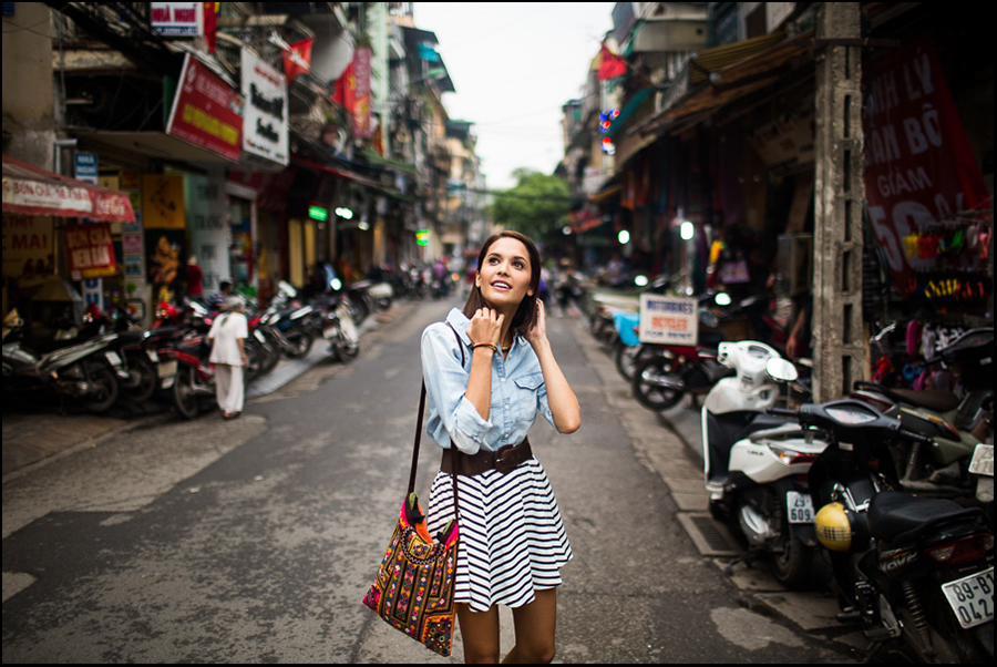 A young woman walks along the streets of the Old Quarter in Hanoi, Vietnam.