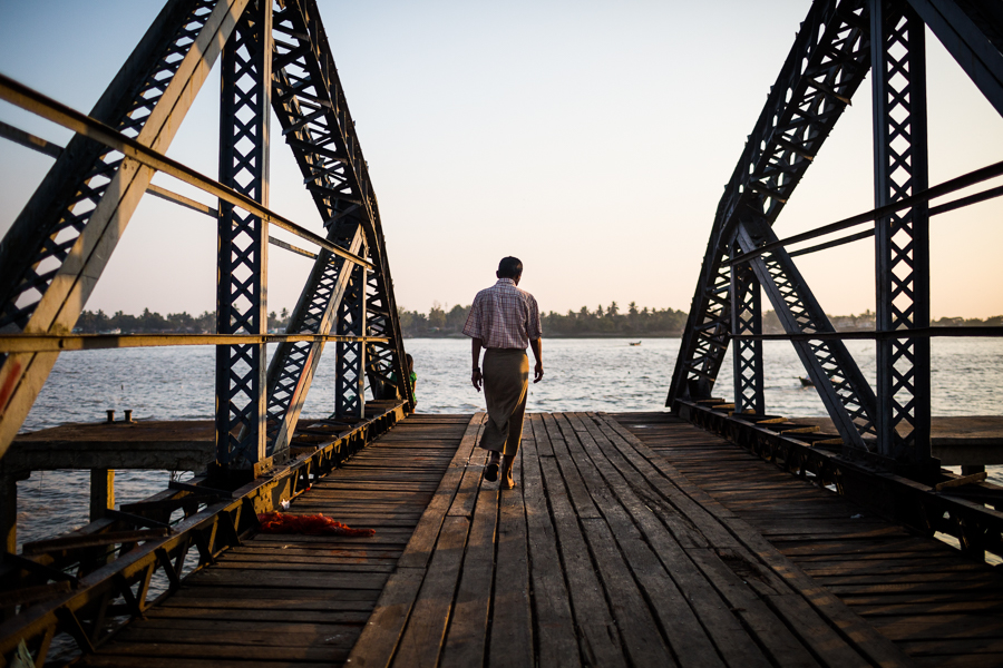 A man walks along a pier toward the Yangon River in downtown Yangon, Myanmar.