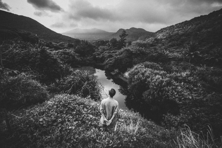 A man looks over a landscape in Con Dao, Vietnam.