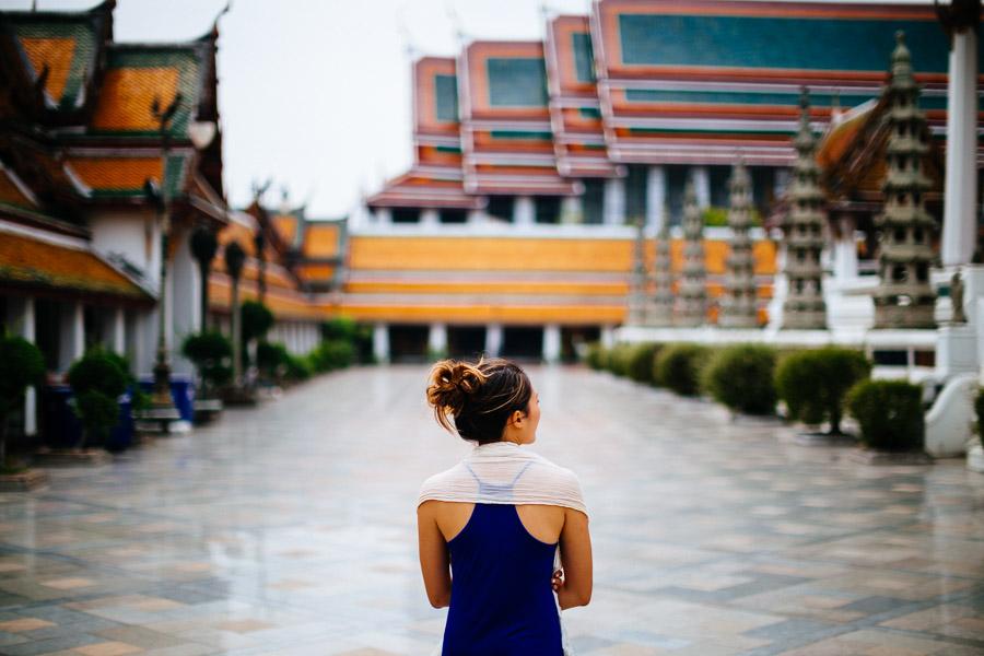 A woman walks through Wat Suthat in Bangkok, Thailand.