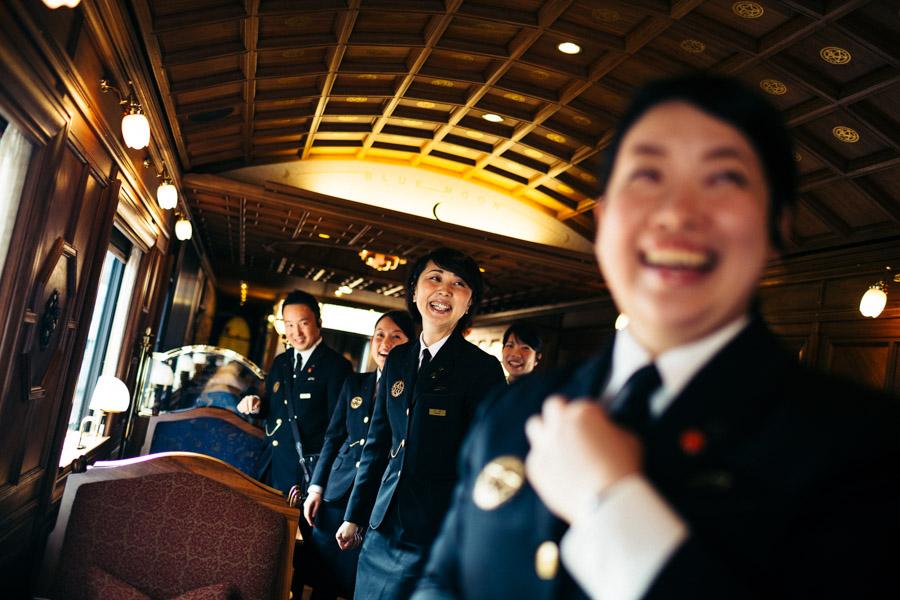 Staff on board the Seven Stars Kyushu luxury train in Japan.