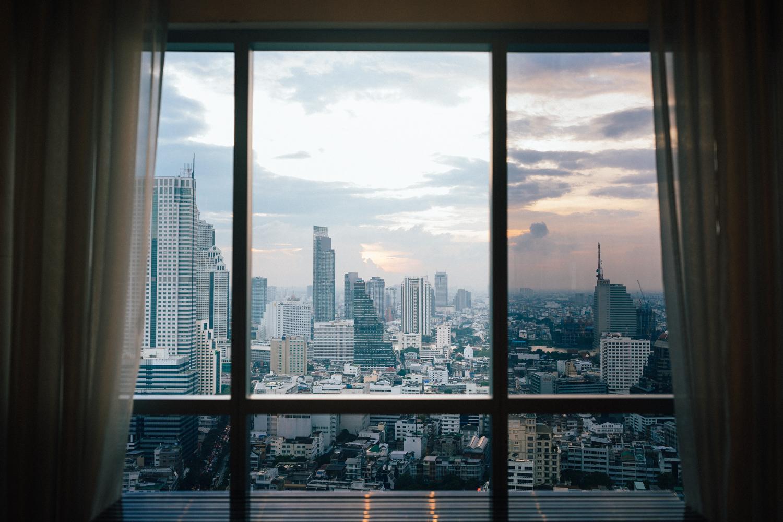 A cityscape of Bangkok, Thailand through a hotel window.