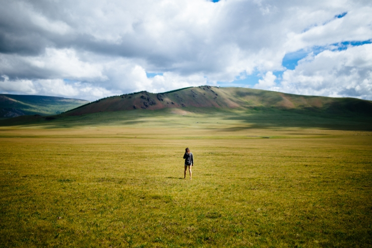 A young woman walks into the open plains of northern Mongolia.